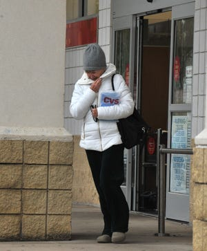 Wichitans bundle up Monday morning in preparation of the cold temperatures that were expected throughout the day.