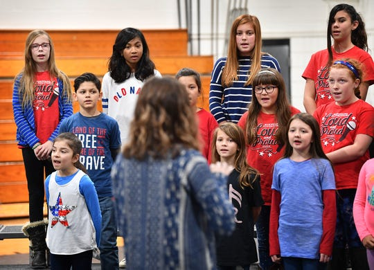 Members of the Sheppard Elementary Choir led by Stephanie Benson sing patriotic songs during the Veterans Day ceremony presented by the Wichita Falls ISD Monday morning at McNiel Middle School.