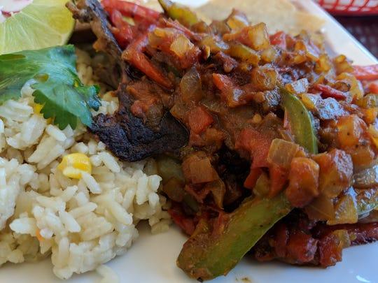 The bistec encebollado at Emanuel #3 Salvadorian and Mexican Restaurant at 902 Board St.