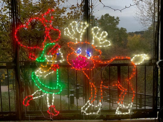 The newest ElectriCritter display is an elf kissing a reindeer. There are 194 displays spread over River Bend Nature Center.