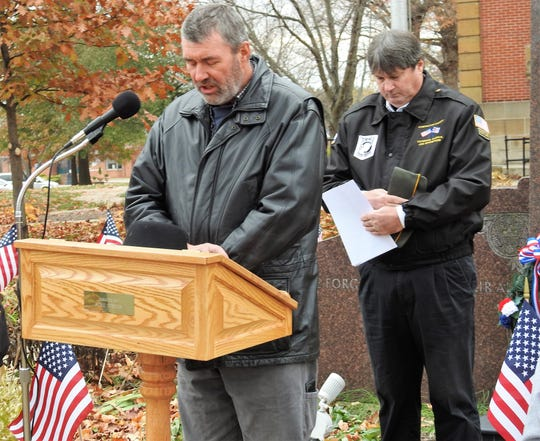 Pastor Mike Jansen of Coshocton Christian Tabernacle, a U.S. Marine Corps veteran, performed the invocation and benediction for a Veterans Day ceremony Monday on the Coshoton Court Square with Jim Barstow, Coshocton County Veterans Service Officer, as emcee.