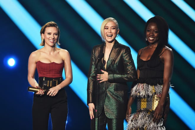 "Actors Scarlett Johansson, Pom Klementieff and Danai Gurira accept The Movie of 2018 award for ""Avengers: Infinity War"" on stage during the 2018 E! People's Choice Awards on Nov. 11, 2018."