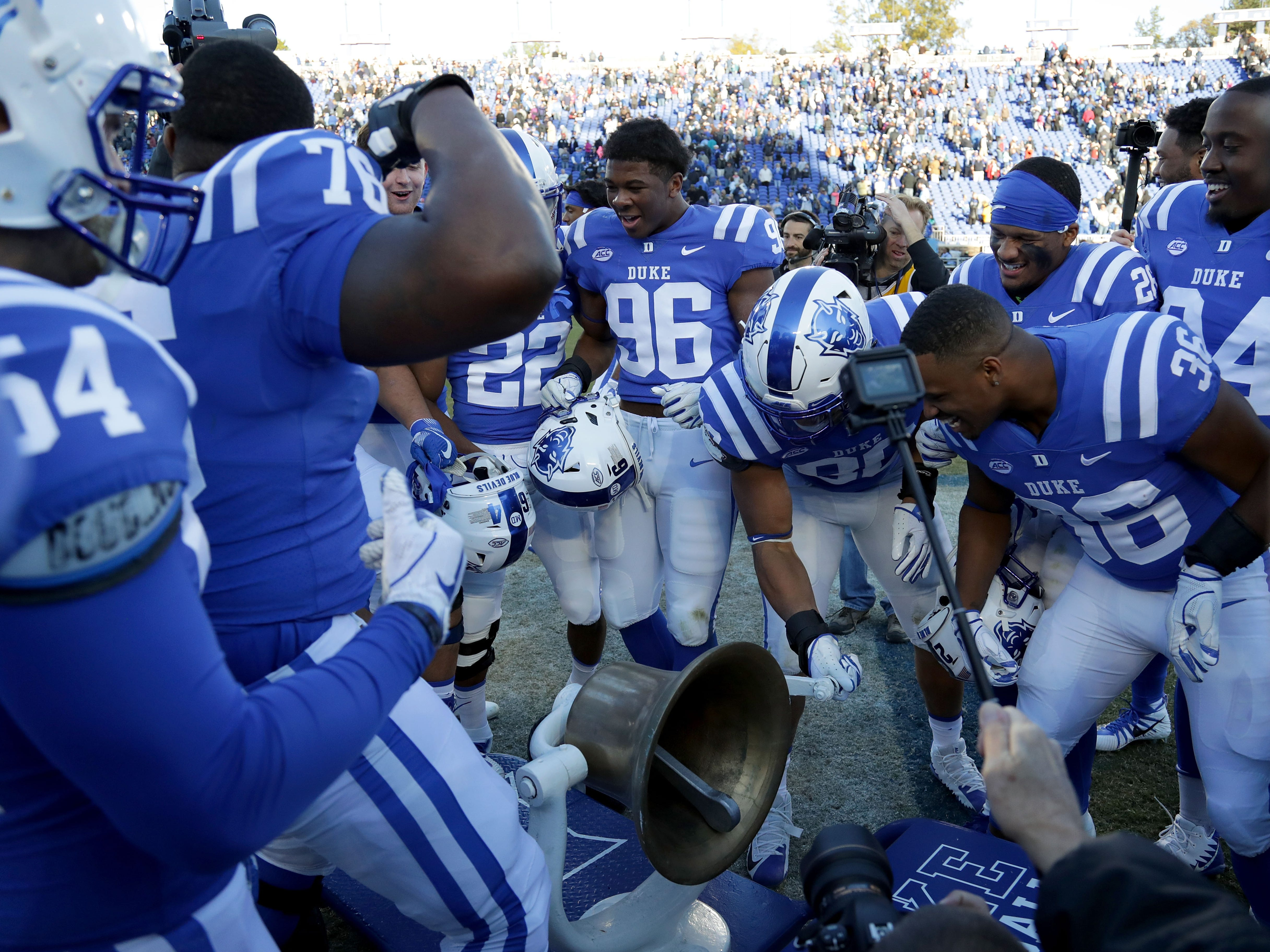 Victory Bell: Duke players celebrate after defeating North Carolina, 42-35, at Wallace Wade Stadium in Durham, N.C. on Nov. 10.