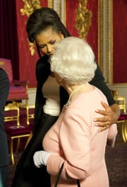Michelle Obama and Queen Elizabeth II at Buckingham Palace on April 1, 2009, bonding over uncomfortable shoes.