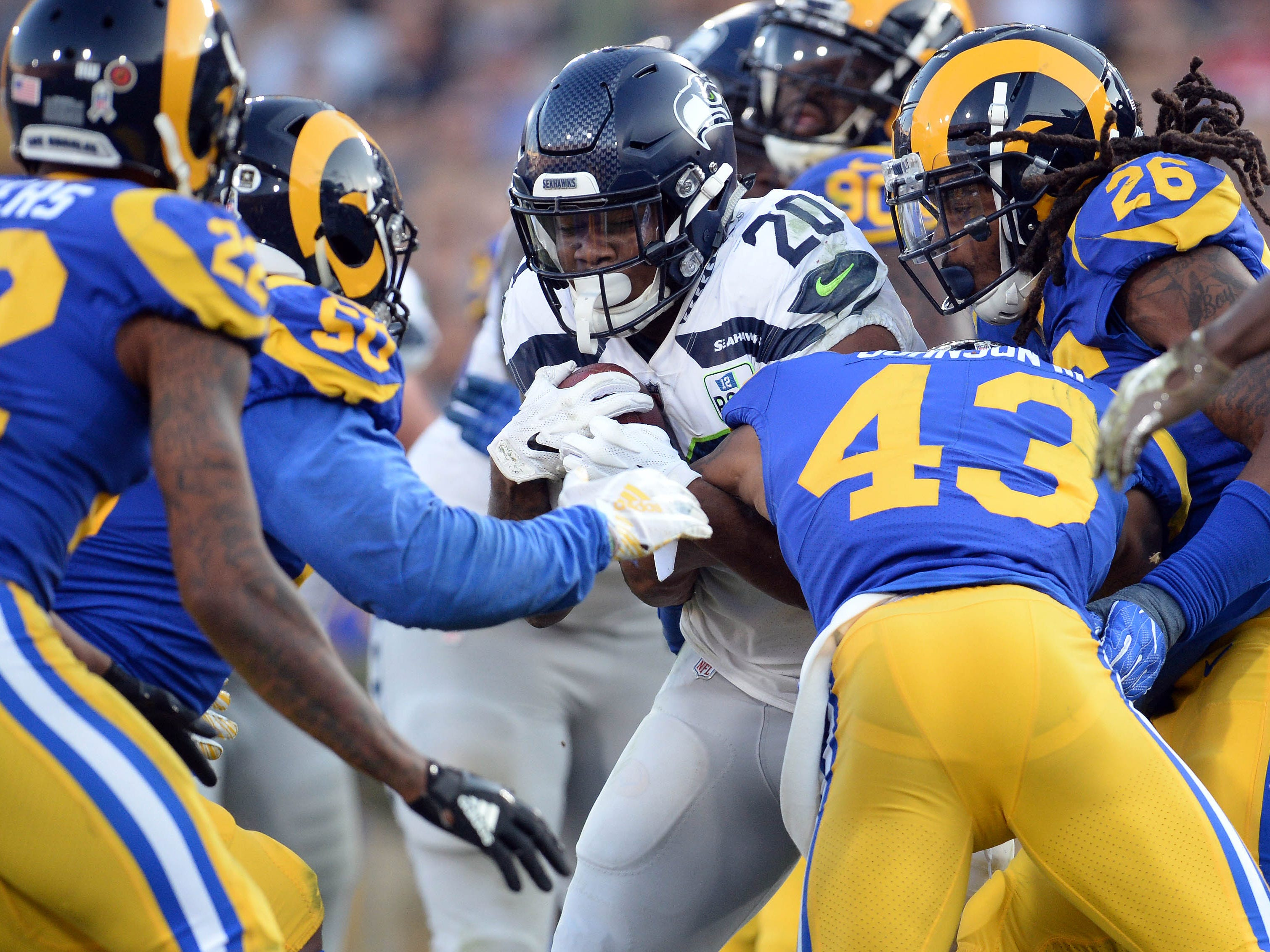 Seattle Seahawks running back Rashaad Penny runs the ball against the Los Angeles Rams during the second half at the Los Angeles Memorial Coliseum.