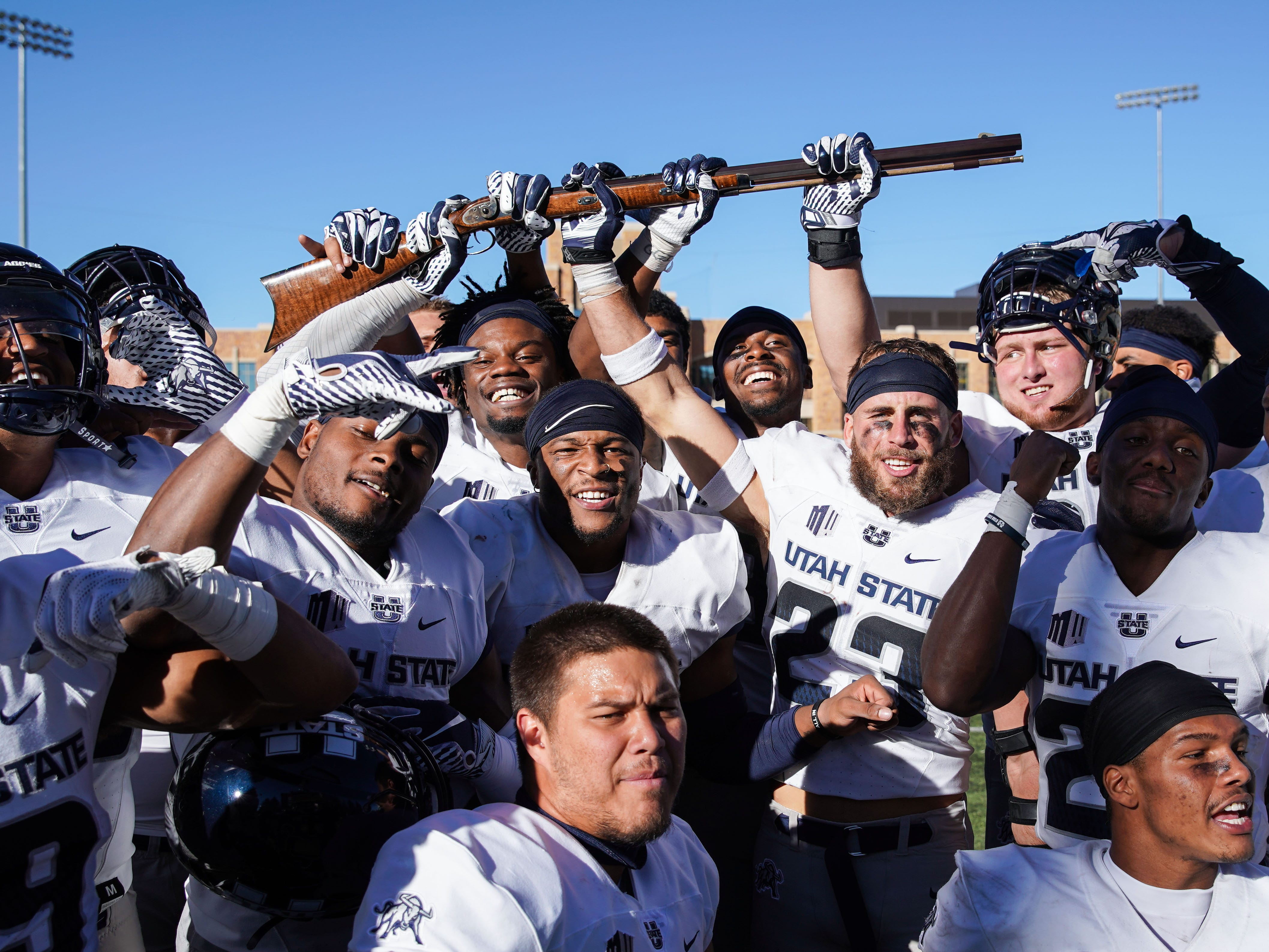 Bridger Rifle: Utah State players hold the Bridger Rifle after a 24-16 win against Wyoming at Jonah Field War Memorial Stadium on Oct. 20.