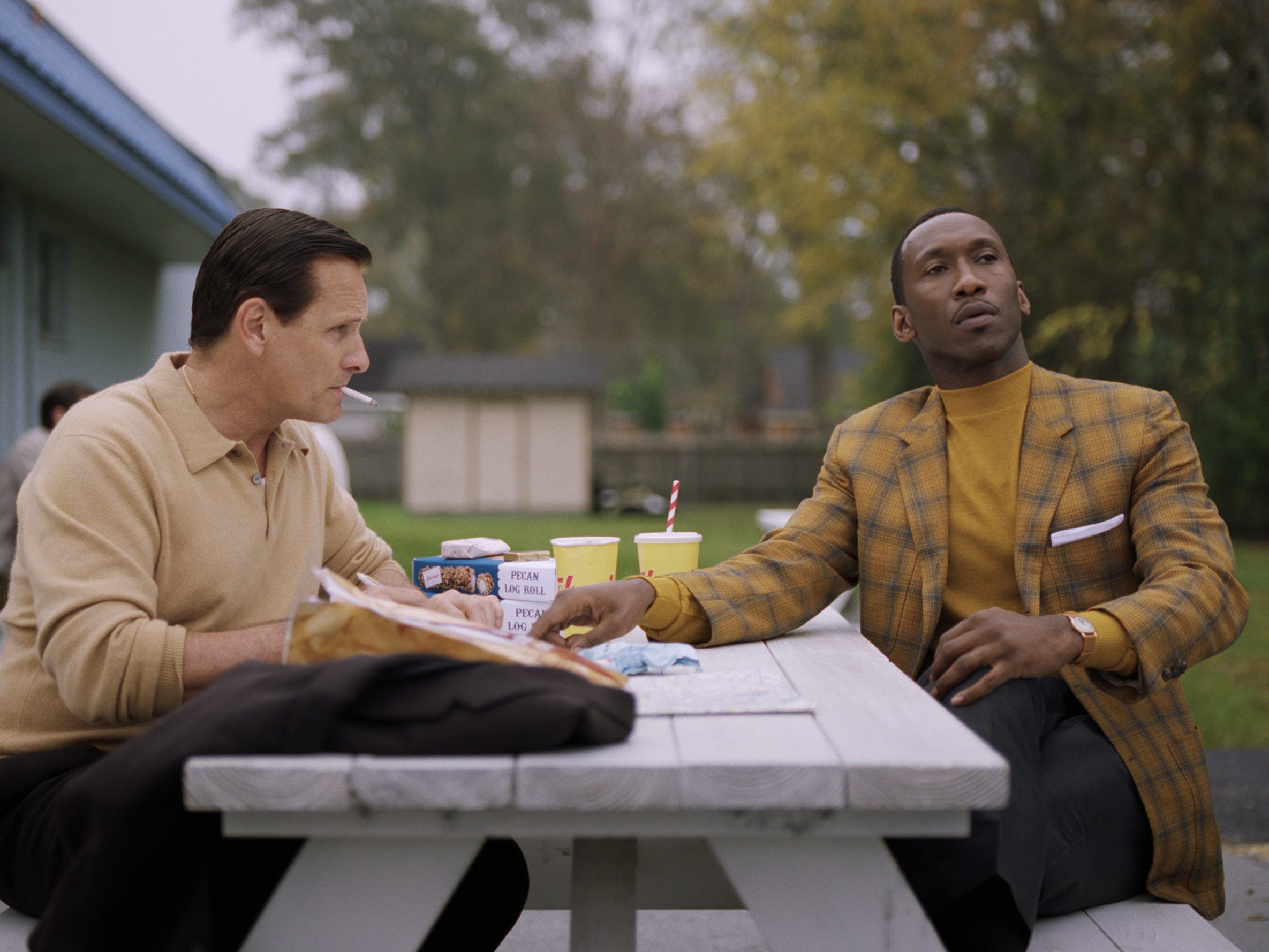 "Tony Lip (Viggo Mortensen, left) gets advice in writing love letters from Don Shirley (Mahershala Ali) in ""Green Book."""
