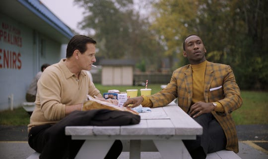 "Tony Lip (Viggo Mortensen, left) gets advice on writing love letters from Don Shirley (Mahershala Ali) in ""Green Book."""
