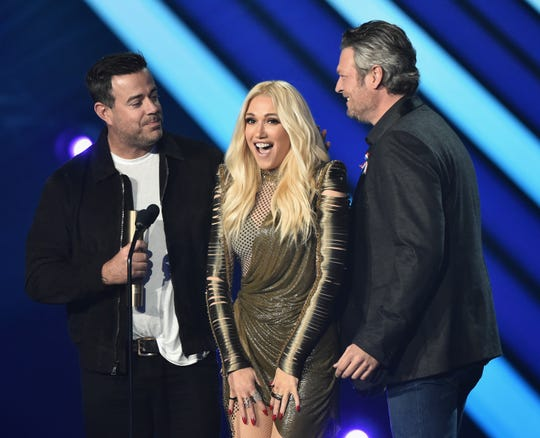 Carson Daly, Gwen Stefani and Blake Shelton on stage during the 2018 E! People's Choice Awards held at the Barker Hangar on Nov. 11, 2018.