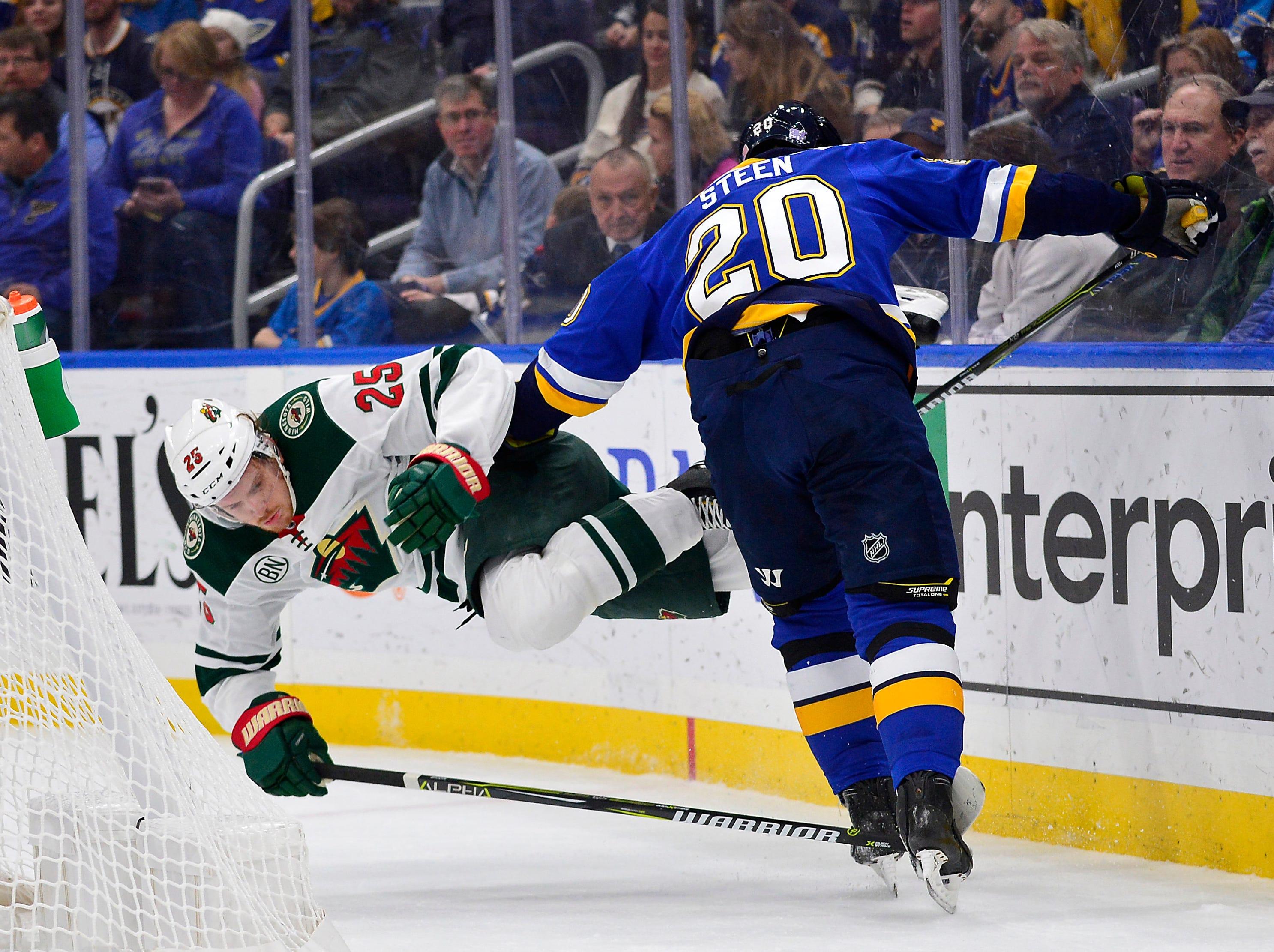 Nov. 11: Minnesota Wild defenseman Jonas Brodin is checked to the ice by St. Louis Blues left wing Alexander Steen (20) during the first period at Enterprise Center.