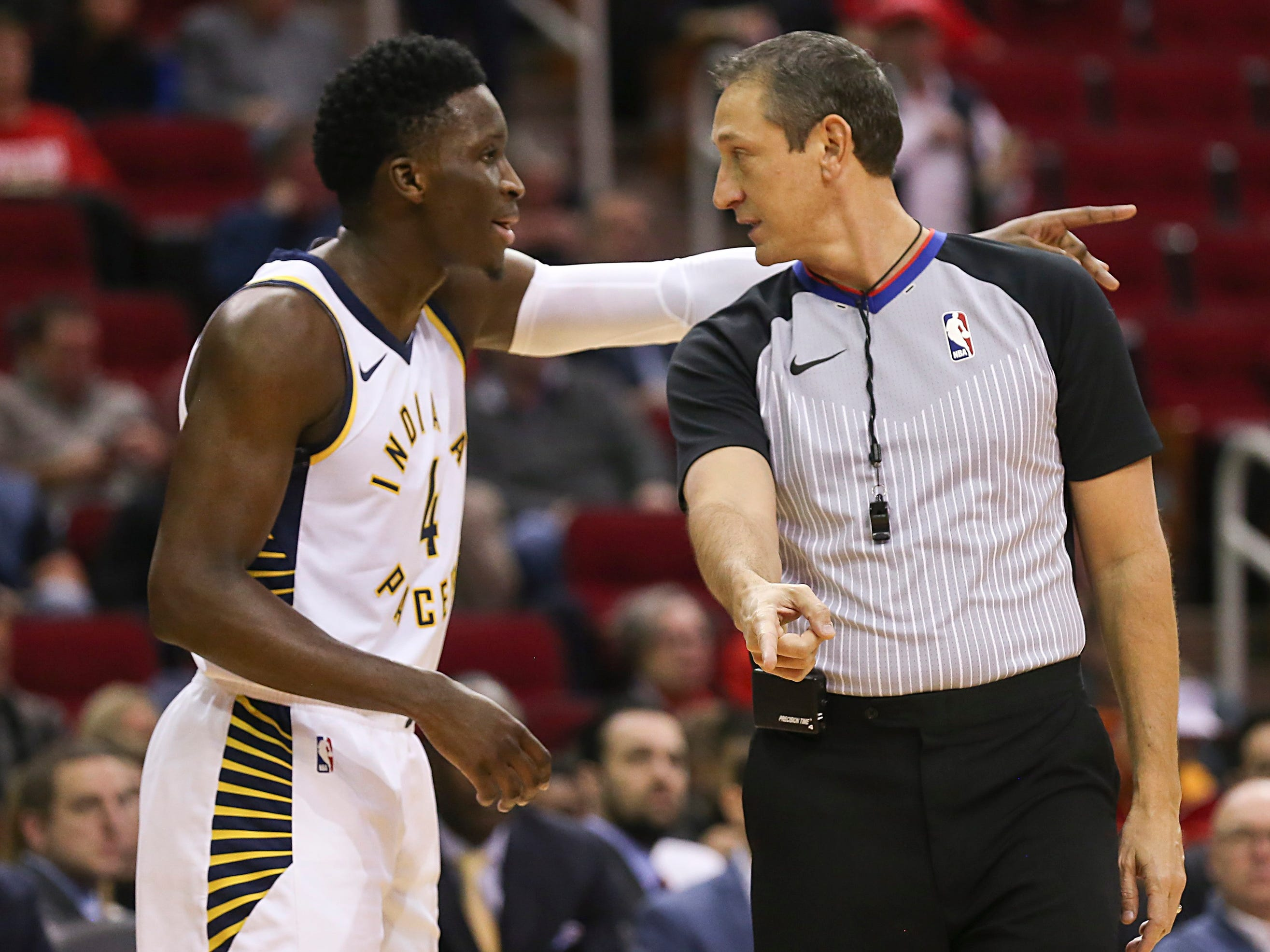 Nov. 11: Pacers guard Victor Oladipo pleads his case with referee Eric Lewis during the first half against the Rockets in Houston.