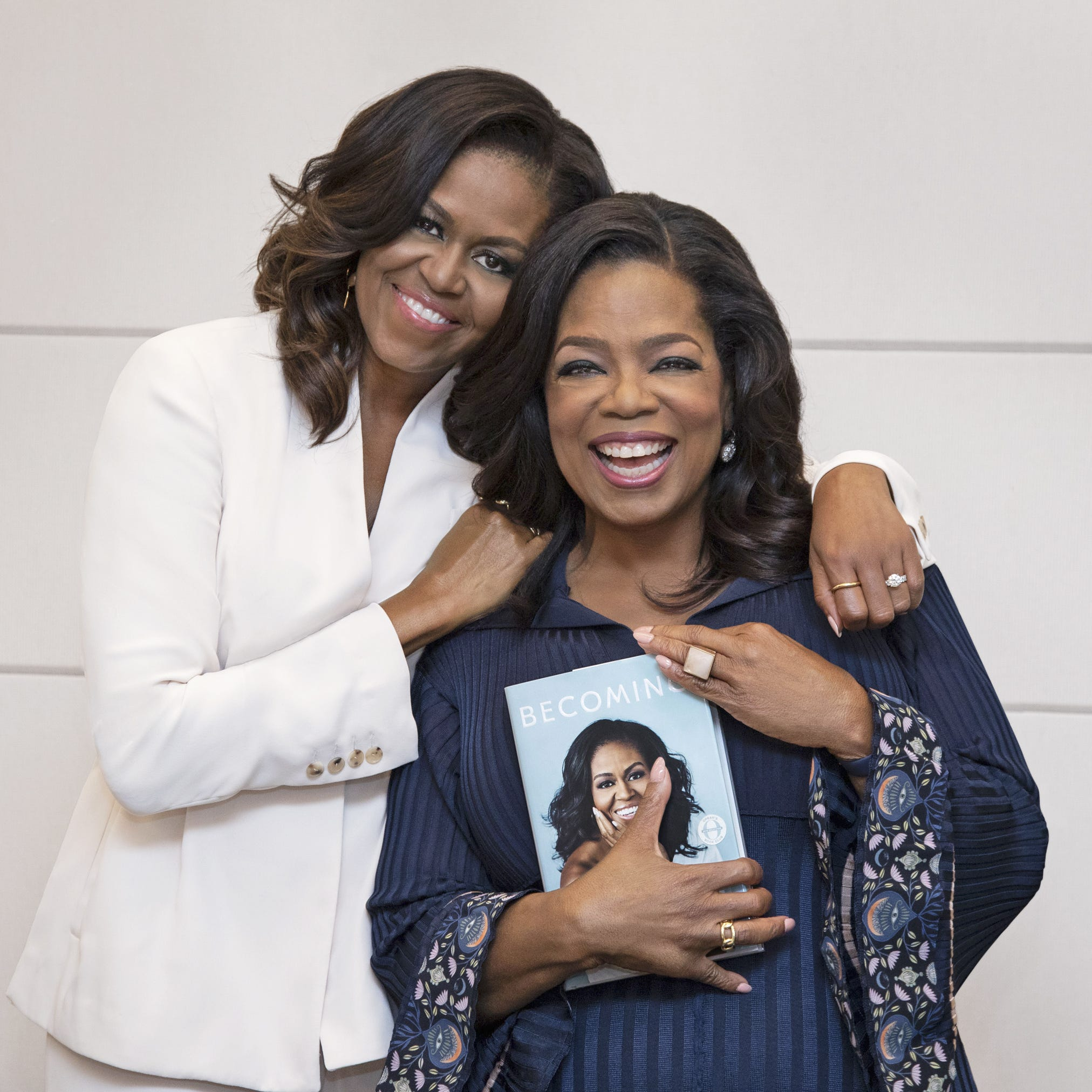 "Michelle Obama, left, has the support of Oprah Winfrey for her new book, ""Becoming."""