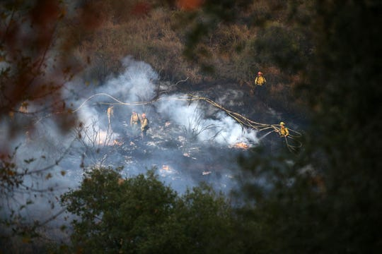 Firefighters from Glendale, Calif., battle flames from the Woolsey Fire on Nov. 11 in Westlake Village, Calif.