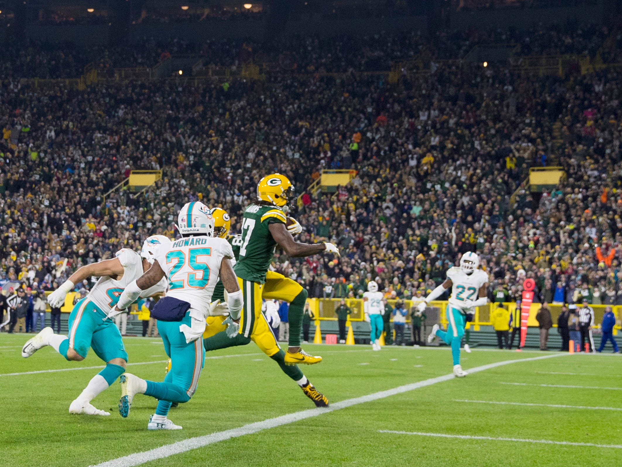 Green Bay Packers wide receiver Davante Adams scores a touchdown pass during the third quarter against the Miami Dolphins at Lambeau Field.