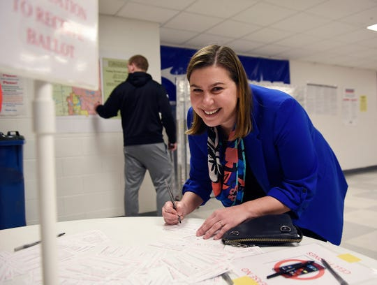 Elissa Slotkin, Democratic candidate for U.S. House of Representatives, fills out her voting card before casting her ballot at the Karl Richter Community Center during election day in Holly, Mich., on Tuesday, Nov. 6, 2018.   (Clarence Tabb Jr./Detroit News via AP) ORG XMIT: MIDTN101