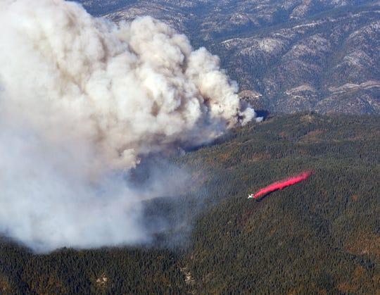An air tanker drops retardant on the Camp Fire near Paradise, Calif. on Nov. 11, 2018.