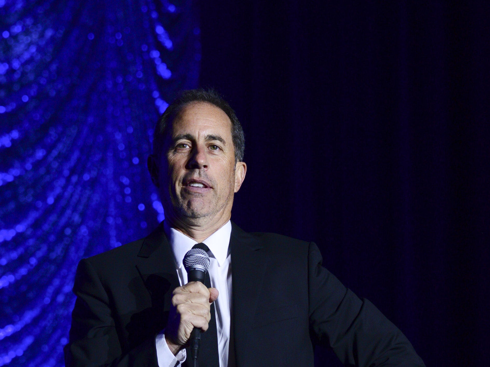 PHILADELPHIA, PENNSYLVANIA - NOVEMBER 10: Jerry Seinfeld performs during Philly Fights Cancer: Round 4 at The Philadelphia Navy Yard on November 10, 2018 in Philadelphia, Pennsylvania. (Photo by Lisa Lake/Getty Images for Philly Fights Cancer) ORG XMIT: 775255610 ORIG FILE ID: 1066224580