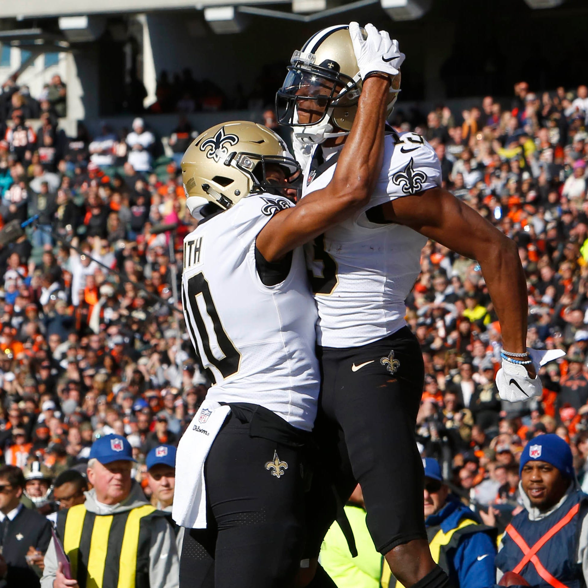 New Orleans Saints wide receiver Michael Thomas (right) reacts with wide receiver Tre'Quan Smith (10) after Thomas scored a touchdown against the Cincinnati Bengals in the first quarter at Paul Brown Stadium.