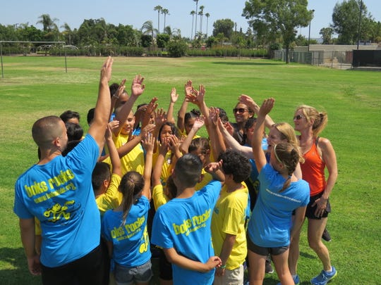 Kathleen Tullie, Reebok's director of social responsibility and founder of the company's BOKS school fitness program, is shown with students at Gladstone Elementary School students in Azusa, Calif. in July 2017.