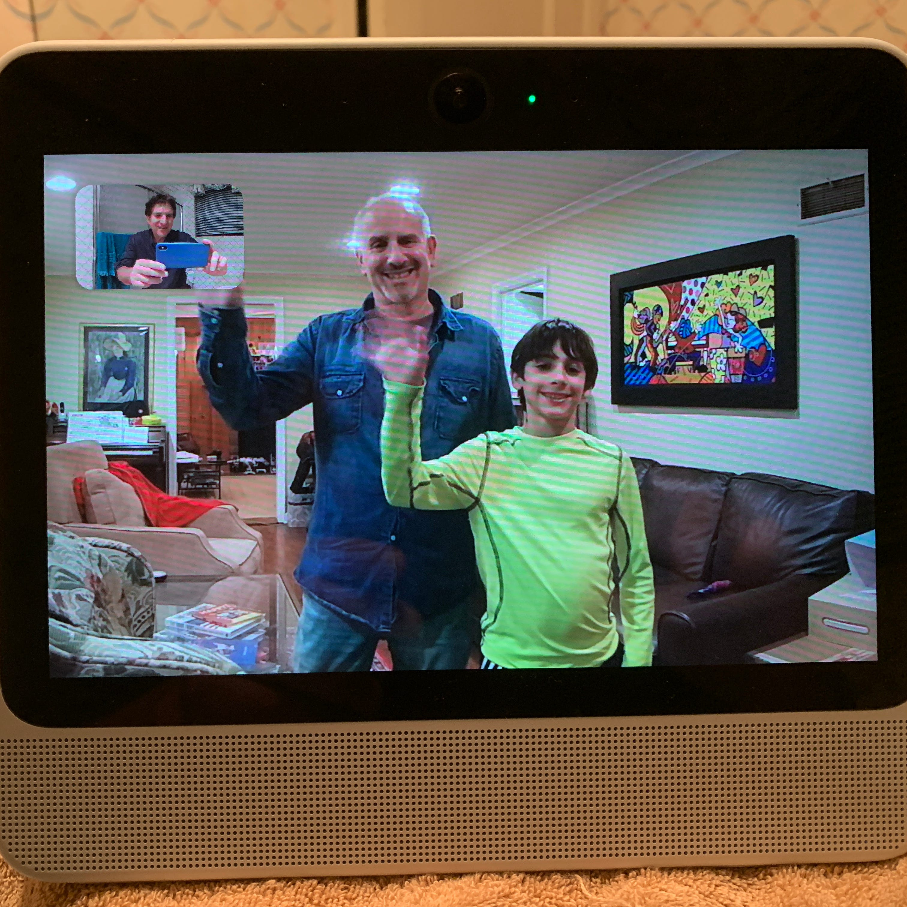 USA TODAY's Edward C. Baig and son Sam waves to Jefferson Graham during a video chat on the Facebook Portal device