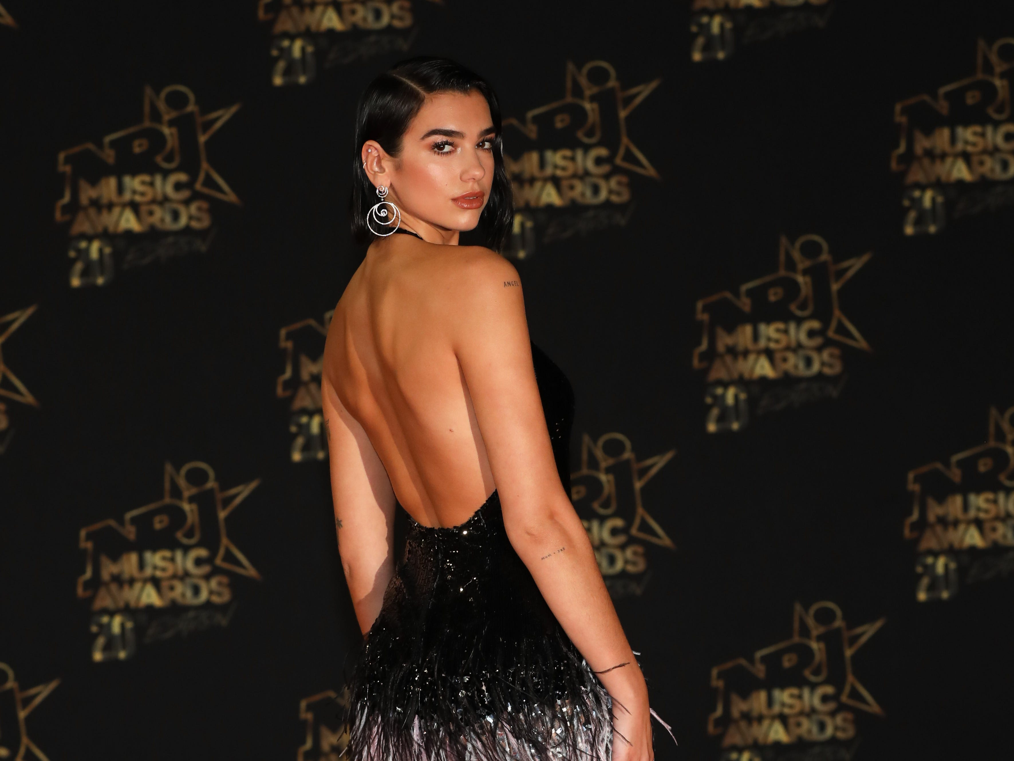 "CANNES, FRANCE - NOVEMBER 10:  Dua Lipa attends the ""20th NRJ Music Awards"" at Palais des Festivals on November 10, 2018 in Cannes, France.  (Photo by Tony Barson/FilmMagic) ORG XMIT: 775256649 ORIG FILE ID: 1060162324"