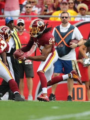 Washington Redskins cornerback Josh Norman (24) runs with the ball as he intercepted the ball against the Tampa Bay Buccaneers during the first quarter at Raymond James Stadium.