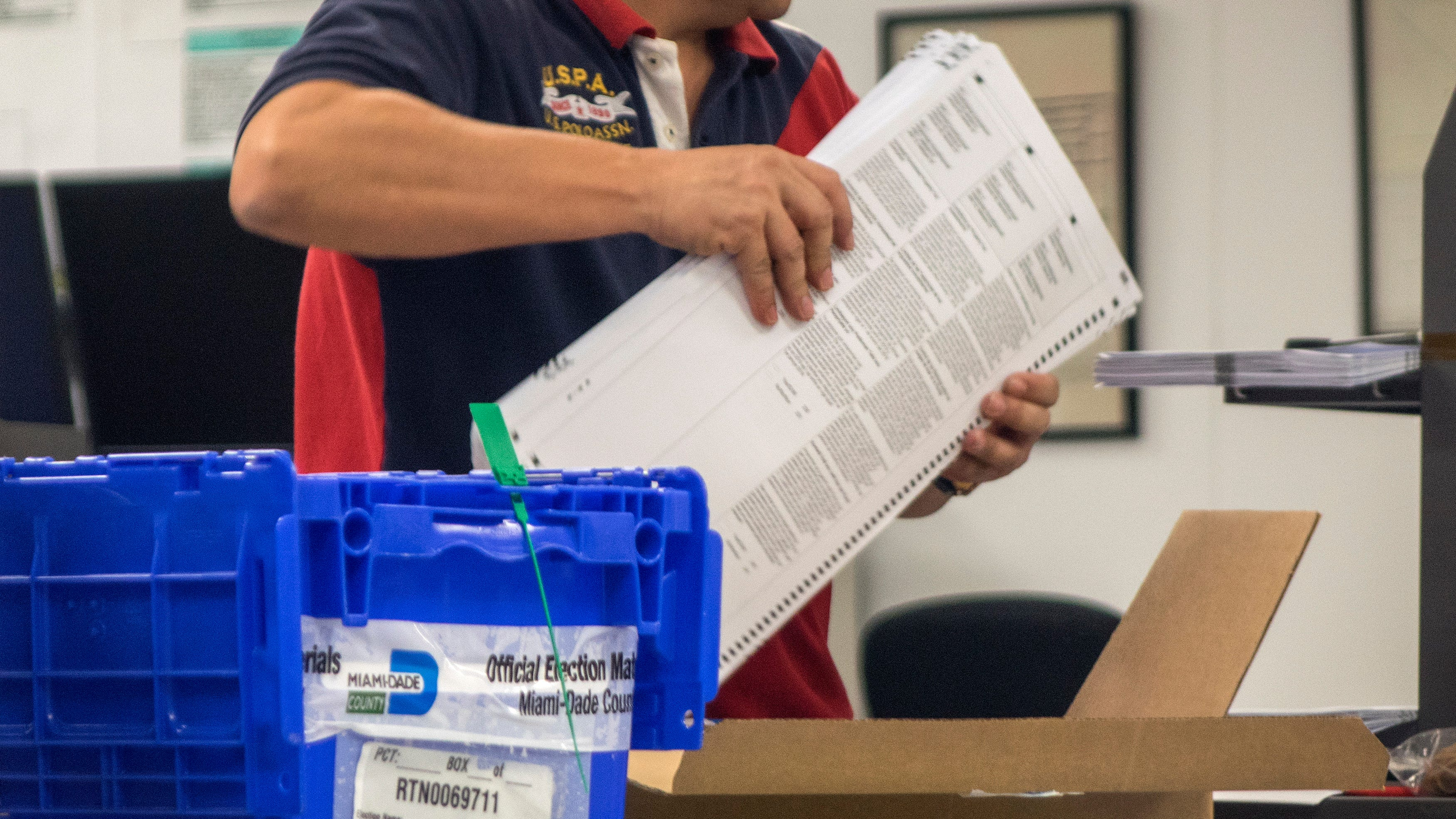 A staff member of the Miami Dade County Election Department works on the recount of the mid-term election vote at the Miami-Dade Election Department in Miami, on Nov. 10, 2018.