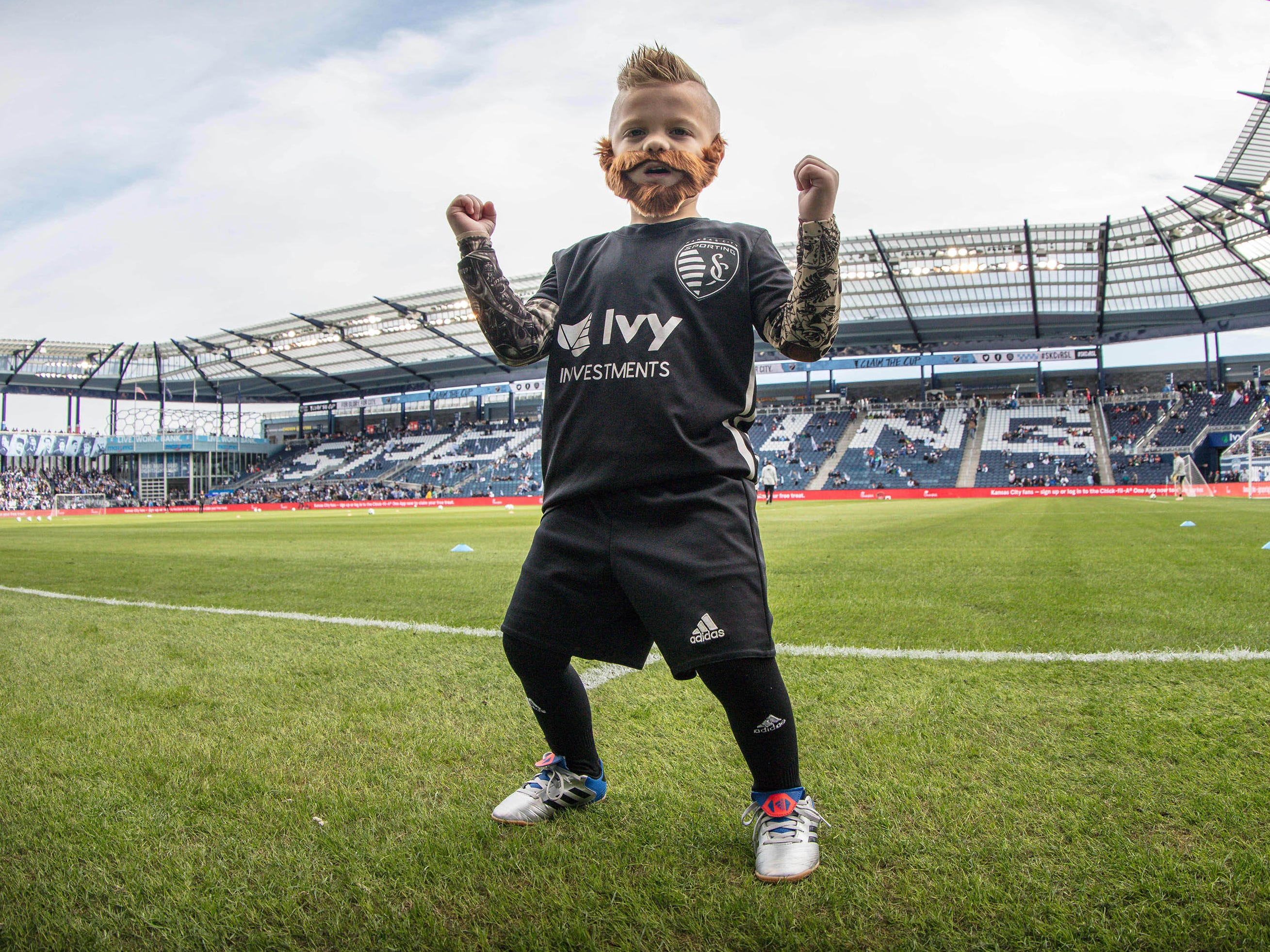A young Sporting Kansas City fan is dressed as forward Johnny Russell for the Western Conference semifinal against the Real Salt Lake at Childrens Mercy Park.