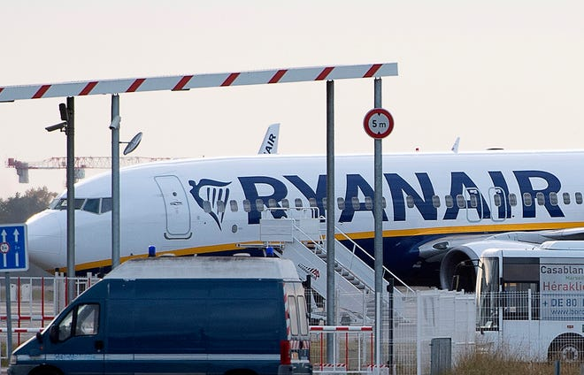 A Ryanair plane sits on the tarmac at the Bordeaux-Merignac airport in southwestern France Thursday after being impounded by French authorities.