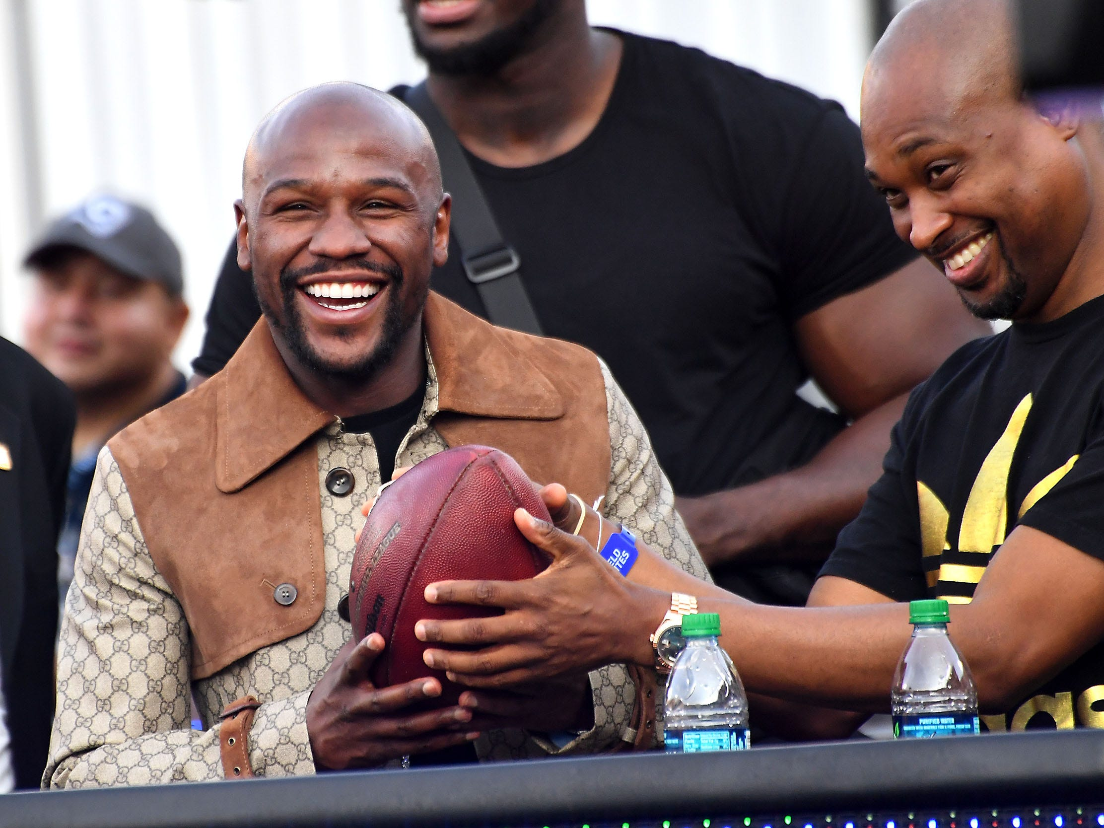 Floyd Mayweather Jr. smiles after Seattle Seahawks wide receiver Tyler Lockett handed him the ball he caught for a touchdown in the second half of the game against the Los Angeles Rams at the Memorial Coliseum.