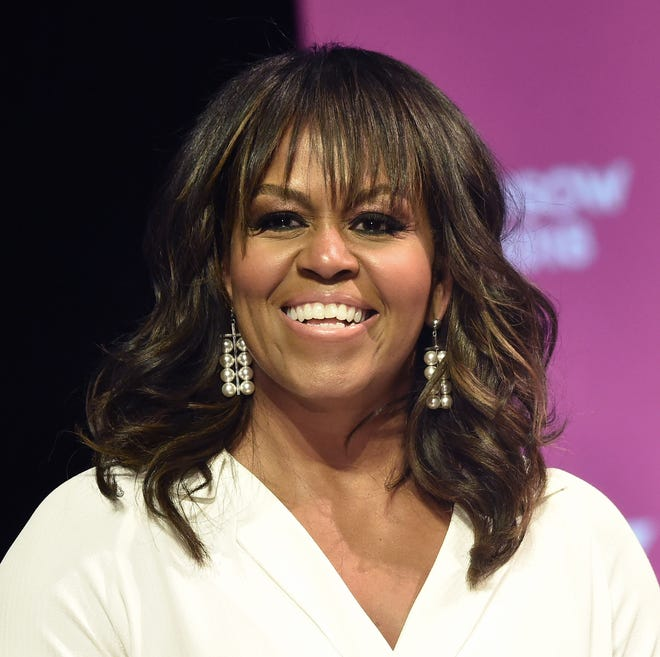 """Michelle Obama (in a May 5, 2018, file photo) shares stories of her life in her new memoir, """"Becoming."""""""