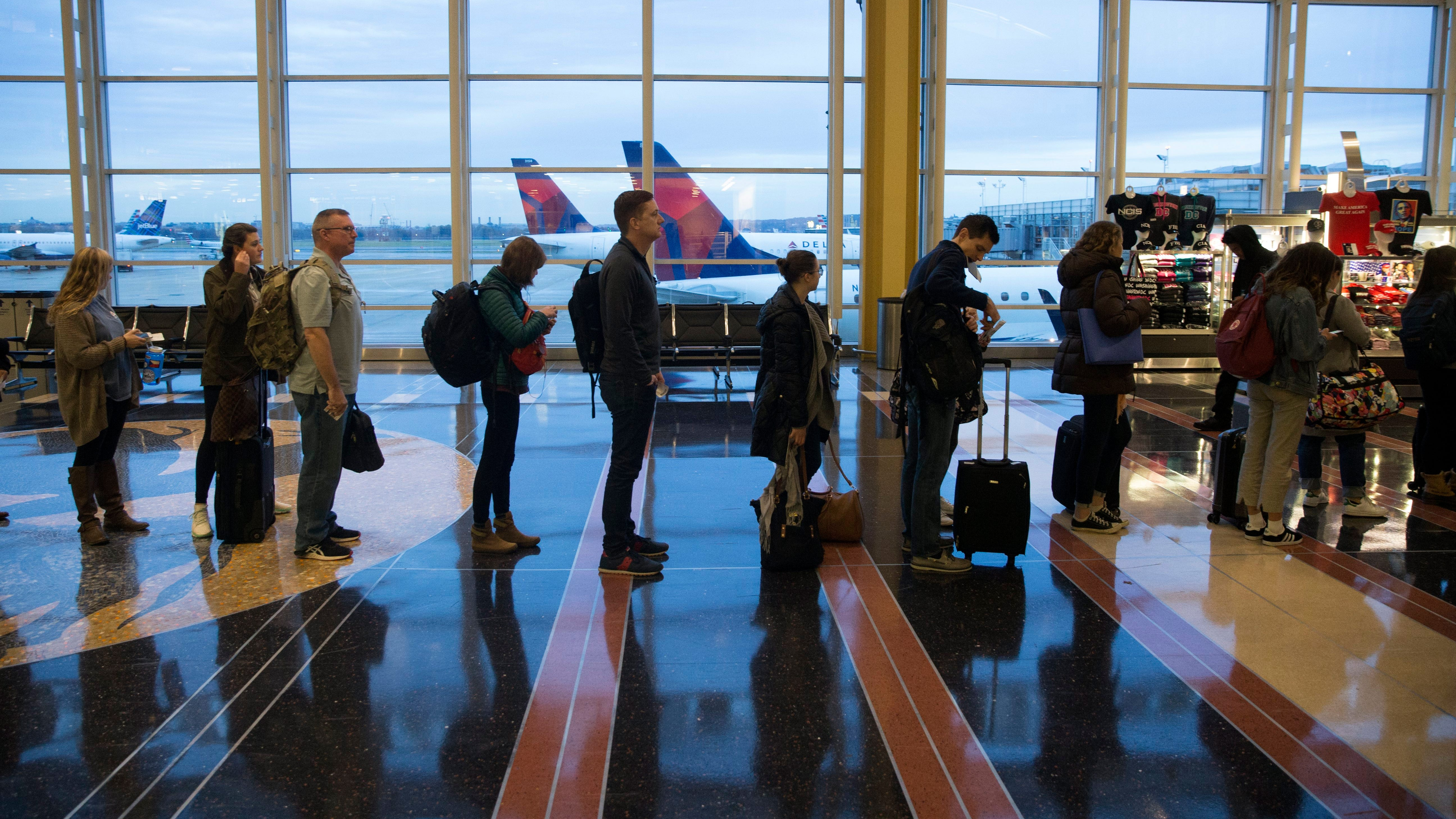 Travelers wait to go through security at Ronald Reagan Washington National Airport on Nov. 22, 2017.