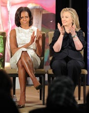 First lady Michelle Obama  and then-Secretary of State Hillary Clinton at the 2012 International Women of Courage Awards ceremony in Washington, D.C., on March 8, 2012. Obama shares advice she got from Clinton in her new book.