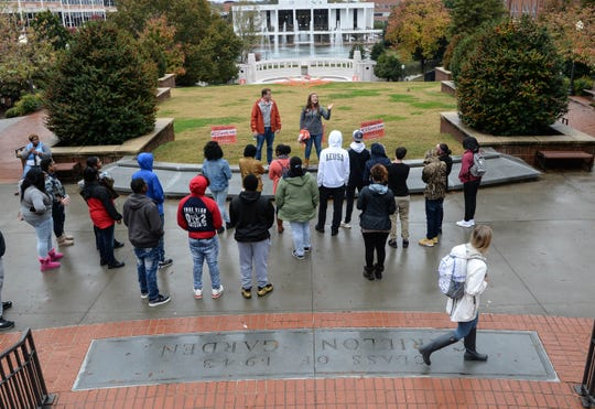 A Clemson student walks by a tour group from Chester High School with guides M.J. Carpenter and Trey Lockett in November.
