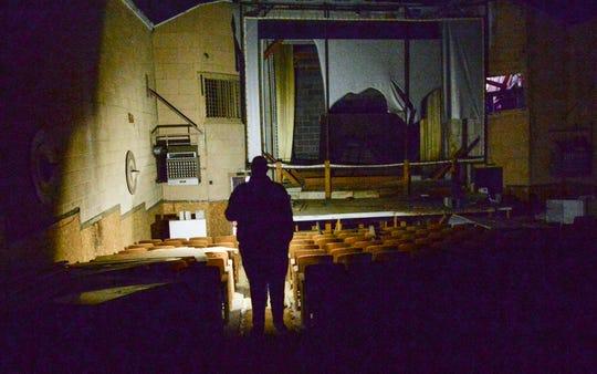 Hack Hammonds of Pelzer looks through the Williamston Theatre on Main Street in Williamston, preparing for demolition in November.