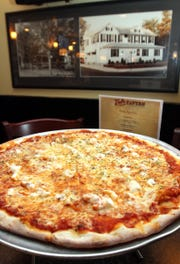 Val's Tavern in Rumson has been serving a lobster-topped pizza since 1942.