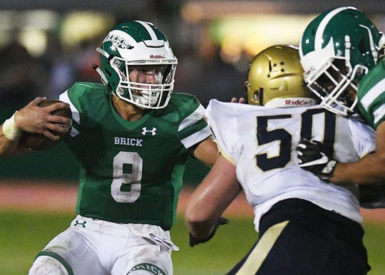 Brick's Jimmy Leblo (8) looks for running room in the Green Dragons' 34-15 win over Freehold.