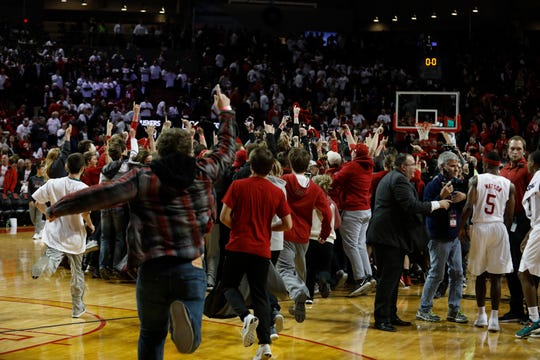 Nebraska Cornhuskers fans run on the court after defeating the Minnesota Golden Gophers in the second half at Pinnacle Bank Arena.