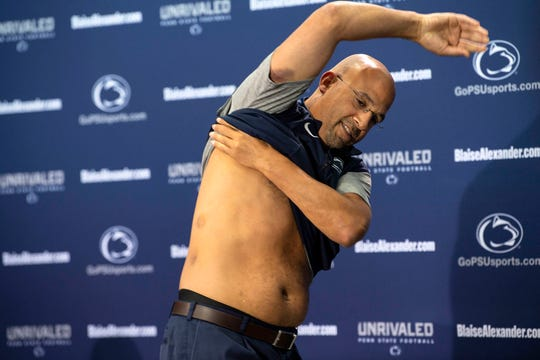 Penn State head coach James Franklin lifts his shirt to reveal welts from a recent players versus coaches paintball game.
