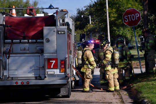 Abilene firefighters stand beside a fire truck on Nov. 13, 2018.