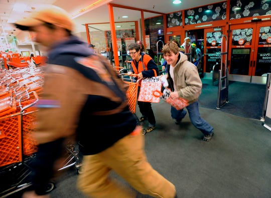 """Doorbusters"" rush into Target in 2009, in one of Black Friday's earlier years. The store opened at 5 a.m. for shoppers to snatch up deals."