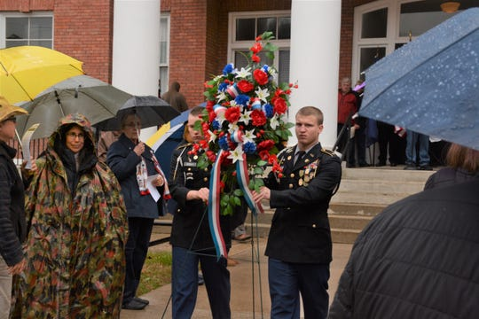 Madison High School JROTC cadets Scott Hensley and Christopher Lanning presented the veterans wreath outside the Madison County Courthouse.