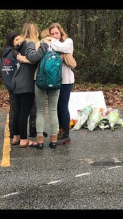 Friends of Lexie Moffitt gathered Tuesday at West Henderson High School to mourn and decorate her parking space. Moffitt was killed Monday in a car wreck.