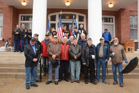 Madison County veterans representing the United States Air Force, Navy, Marines and Army gathered on the Madison County Courthouse steps.