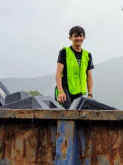 William David of Asheville, seen here volunteering with Asheville GreenWorks' Hard to Recycle program, has won scouting's highest honor in conservation.