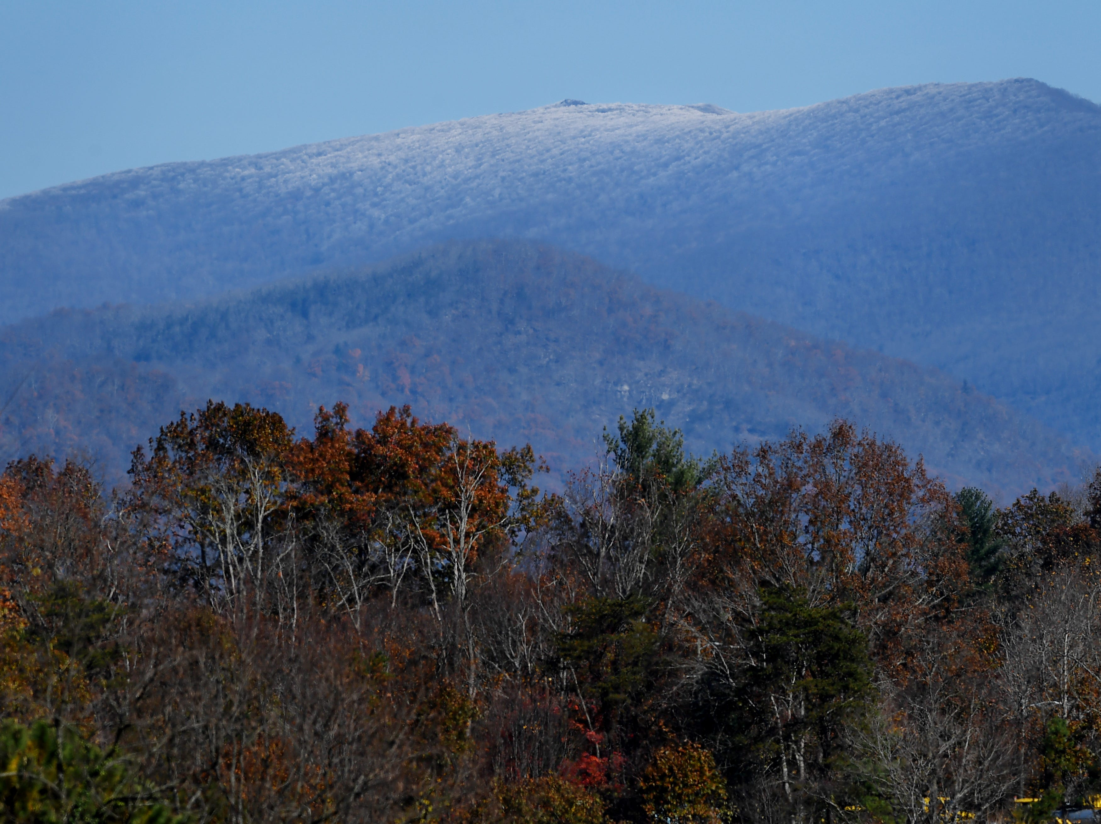 Snow is seen on a mountaintop from Asheville Nov. 10, 2018. The National Weather Service has issued a Winter Storm Watch for the Asheville area and surrounding areas from Wednesday evening into Thursday afternoon.