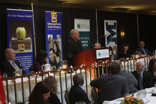 Rev. Clarence Rumble accepts the Non-Profit Organization Award on behalf of  Mercy House of the Southern Tier at the Binghamton Chamber's 22nd Annual Community Thanksgiving Luncheon.
