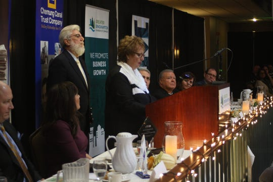 Connie Gault, of Gault Chevrolet Toyota BMW, accepts the Corporate Citizen Award on behalf of Gault at the Binghamton Chamber's 22nd Annual Community Thanksgiving Luncheon.