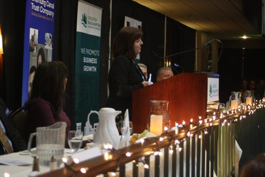 Amelia LoDolce, executive director of VINES Community Gardens, accepts the Community Advocate Award on behalf of VINES at the Binghamton Chamber's 22nd annual Community Thanksgiving Luncheon.