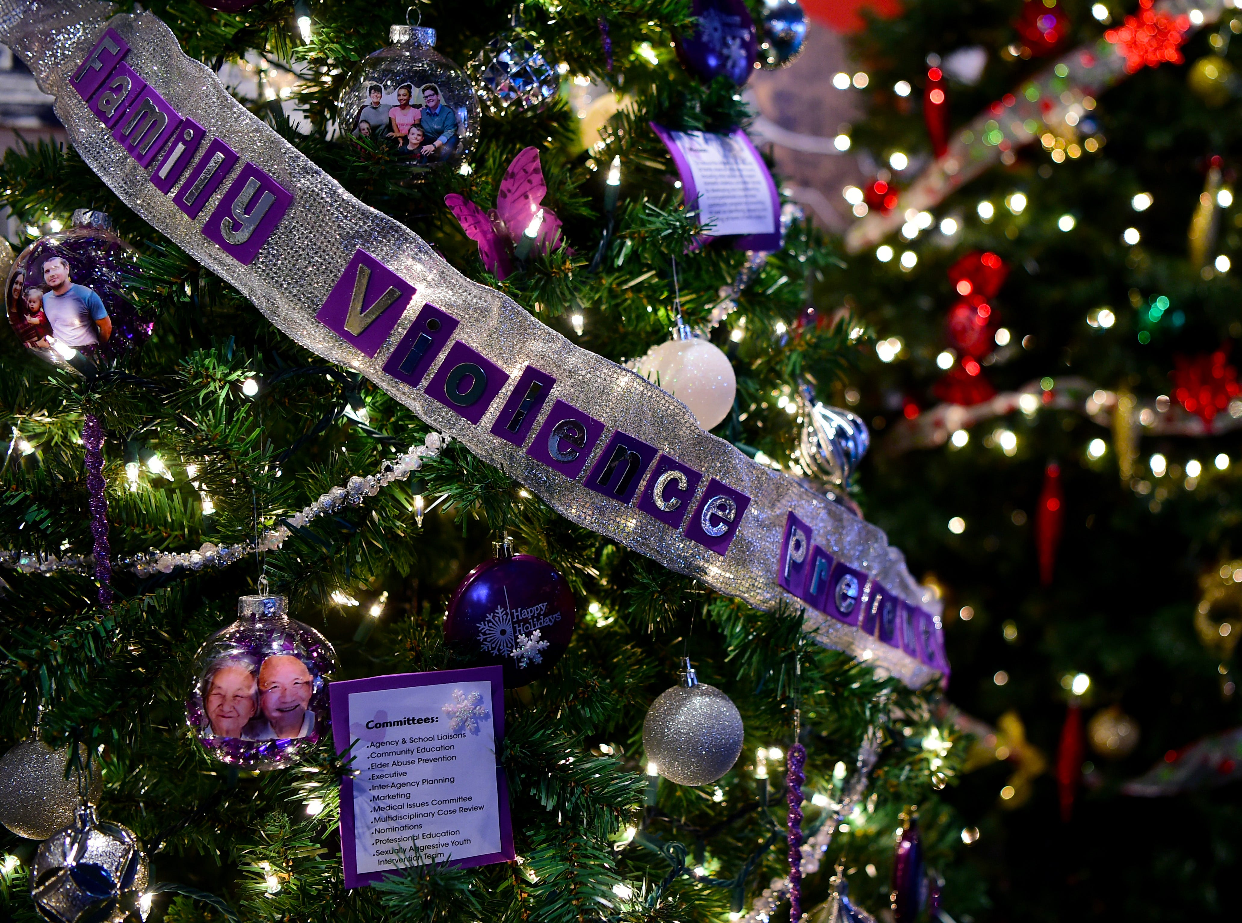 Tree decorated by Broome County Family Violence Prevention Council. Roberson Museum and Science Center's annual Home for the Holidays event opens on November 14 and continues through January 6. The event features hundreds of elaborately decorated holiday trees and displays. November 12, 2018.